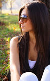 Woman in dark glasses. Beautiful young woman in dark glasses in park Royalty Free Stock Photos