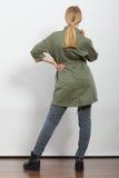 Woman in dark green jacket. Autumn fashion Royalty Free Stock Photos