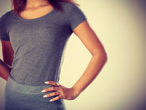 Woman in dark grey top with short sleeve Stock Photography