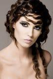 Woman with dark hair. Stock Photos