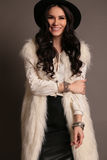 Woman with dark hair and smokey eyes makeup,wears luxurious fur coat, Stock Photography
