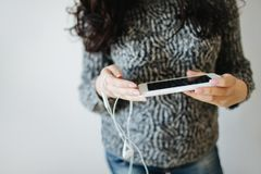 Woman with dark hair using mobile phone. royalty free stock image