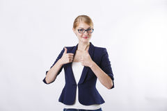 Woman in dark jacket  with glasses thumbs up Royalty Free Stock Photography