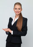 Woman in a dark suit Stock Image