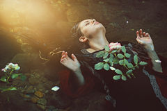 Woman in dark water stream and soft sunlight Royalty Free Stock Image