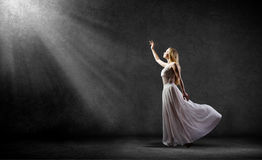 Woman in darkness Stock Images