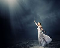 Woman in darkness stock photo