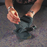 Woman darning sock Royalty Free Stock Image