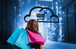 Woman in a data center holding shopping bags Royalty Free Stock Photography