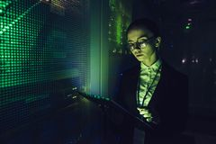 Woman in data centre. Attractive woman is working in data centre with tablet.IT engineer specialist in network server room.Running diagnostics and maintenance stock images