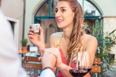 Young couple on a date. Woman on a date holding her boyfriend`s hand royalty free stock photos