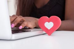 Woman Dating Online On Laptop At Home. Close-up of young woman dating online on laptop at home royalty free stock photo