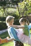 Woman And Daughter Enjoying At Park Stock Photos
