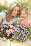 Woman With Daughter Gardening Together Stock Image
