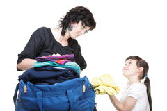 Woman and daughter hand crammed full of clothes and shoulder bag Stock Photo