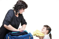 Woman and daughter hand crammed full of clothes and shoulder bag Royalty Free Stock Photography
