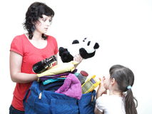 Woman and daughter hand crammed full of clothes and shoulder bag Royalty Free Stock Image