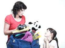 Woman and daughter hand crammed full of clothes and shoulder bag Stock Image