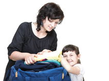 Woman and daughter hand crammed full of clothes and shoulder bag Stock Photography