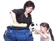 Woman and daughter hand crammed full of clothes and shoulder bag Stock Photos