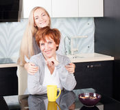 Woman with daughter on kitchen Royalty Free Stock Photography