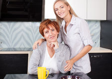 Woman with daughter on kitchen Royalty Free Stock Images