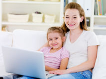 Woman with daughter with laptop Royalty Free Stock Photo