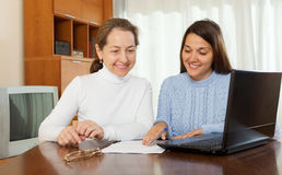 Woman and daughter with laptop Royalty Free Stock Image