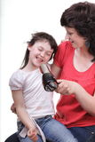 Woman and daughter Little girl dries hair isolated Royalty Free Stock Photo