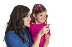 Woman and daughter looking and pointing Royalty Free Stock Photos