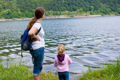 Woman with daughter in the nature Royalty Free Stock Image