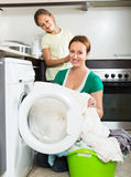 Woman with daughter near washing machine Royalty Free Stock Photo