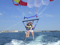 Woman and daughter parasailing Royalty Free Stock Photo