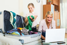 Woman with daughter planning vacation Stock Photo