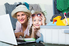 Woman with daughter planning vacation Stock Photography