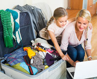 Woman with daughter planning vacation Royalty Free Stock Images
