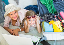 Woman with daughter planning vacation Royalty Free Stock Photos