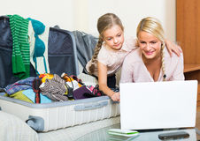 Woman with daughter planning vacation Royalty Free Stock Photography