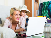 Woman with daughter planning vacation Stock Photos
