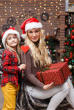 Woman and daughter with present Royalty Free Stock Image