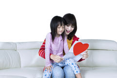 Woman and daughter read greeting card Stock Images
