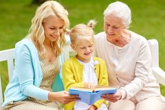Woman with daughter and senior mother at park Stock Photo