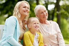 Woman with daughter and senior mother at park Royalty Free Stock Images