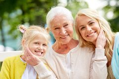 Woman with daughter and senior mother at park Stock Photos