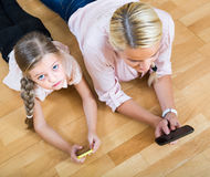 Woman and daughter with smartphones Stock Photo
