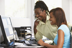 Woman And Daughter Use A Computer Royalty Free Stock Photo