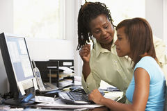 Woman And Daughter Use A Computer Stock Image