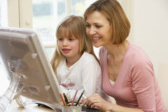 Woman And Daughter Using Computer Royalty Free Stock Photo