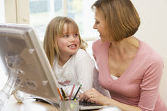 Woman And Daughter Using Computer Royalty Free Stock Image