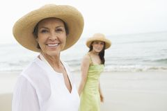 Woman And Daughter Walking At Beach Royalty Free Stock Photography